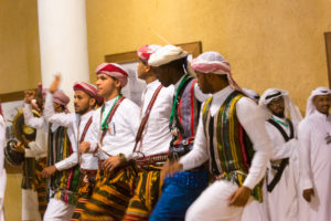 men dancing in ethnic clothing