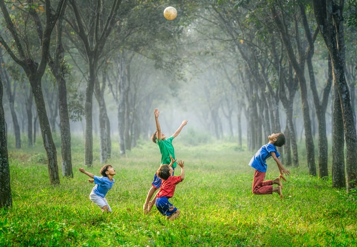 Kids playing in a field.