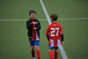 Two boys in soccer field