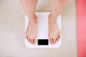 Standing on the weighing scale after healthy eating